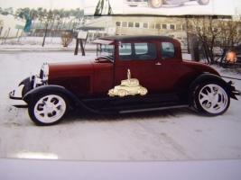 Auto, das fertige Modell, der Anhänger hat eine Länge von 1,5 cm und ist aus 585 Gelbgold gefertigt.